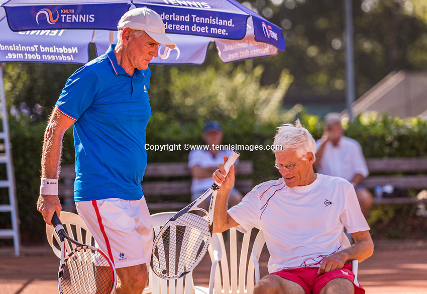 Hilversum, The Netherlands,  August 21, 2020,  Tulip Tennis Center, NKS, National Senior Tennis Championships, Men's single 70+,  Frank van Lerven (NED) passing Huug van Wingerden (NED) at changeover<br /> Photo: Tennisimages/Henk Koster