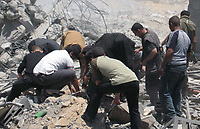 "Palestinians search for dead bodies under the rubble of a destroyed compound used by Hamas's Executive Force, after an Israeli air strike in Gaza May 26, 2007. Israel pounded Hamas positions in the Gaza Strip on Saturday, killing at least four fighters, and seized a minister in Palestinian Prime Minister Ismail Haniyeh's cabinet, stepping up a campaign against the ruling Islamists.""photo by Fady Adwan"""