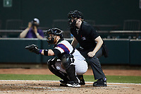 Winston-Salem Rayados catcher Gunnar Troutwine (12) sets a target as home plate umpire Mitch Leikam looks on during the game against the Llamas de Hickory at Truist Stadium on July 6, 2021 in Winston-Salem, North Carolina. (Brian Westerholt/Four Seam Images)