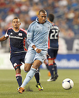 Sporting Kansas City forward Teal Bunbury (9) on the attack. In a Major League Soccer (MLS) match, Sporting Kansas City defeated the New England Revolution, 1-0, at Gillette Stadium on August 4, 2012.