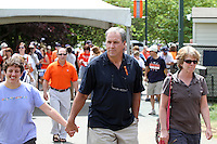 The head coach for the University of Virginia men's lacrosse team Dom Starsia, middle, attends the first University of Virginia women's lacrosse game since the tragic death of teammate Yeardley Love Sunday May 16, 2010 at Klockner Stadium in Charlottesville, Va. The Cavaliers rallied in the last four minutes to beat Towson 14-12 and reach the quarter finals of the NCAA tournament. Love's body was found May 3, and Virginia men's lacrosse player George Huguely is charged with murder. Photo/Andrew Shurtleff..