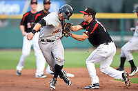 Rochester Red Wings third baseman Doug Bernier (17) tags out Chase d'Arnaud (15) during a game against the Indianapolis Indians on July 26, 2014 at Frontier Field in Rochester, New  York.  Rochester defeated Indianapolis 1-0.  (Mike Janes/Four Seam Images)