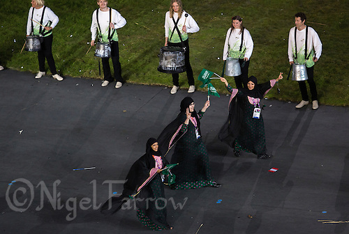27 JUL 2012 - LONDON, GBR - Female competitors from Saudi Arabia (KSA) walk around the Olympic Stadium during the Opening Ceremony of the London 2012 Olympic Games in Stratford, London, Great Britain (PHOTO (C) 2012 NIGEL FARROW)