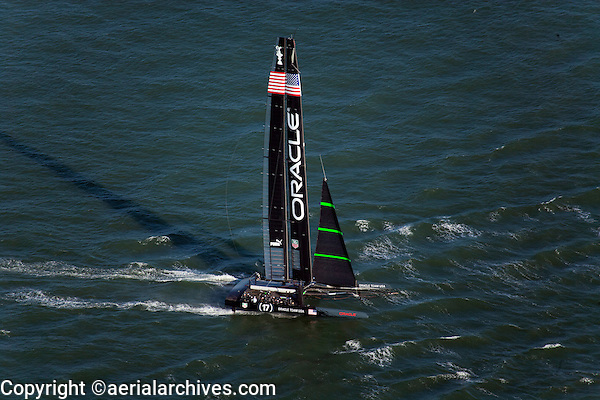 aerial photograph of Oracle's sailboat racing in the America's Cup, San Francisco bay, California