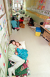 A mother and her 4 year-old daughter try to rest in the hallway of the Popps Ferry Elementary School as Hurricane Georges bore down on Biloxi along the Mississippi coast September 27, 1998.  Georges made six landfalls through the Caribbean Sea and Gulf of Mexico before making it's 7th and final landfall near Biloxi.  604 people were killed mostly in Dominican Republic and haiti.  Because of the extensive damage, the name Georges was retired and will never be used again.