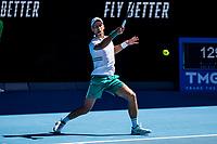 10th February 2021, Melbourne, Victoria, Australia; Novak Djokovic of Serbia returns the ball during round 2 of the 2021 Australian Open on February 10 2020, at Melbourne Park in Melbourne, Australia.