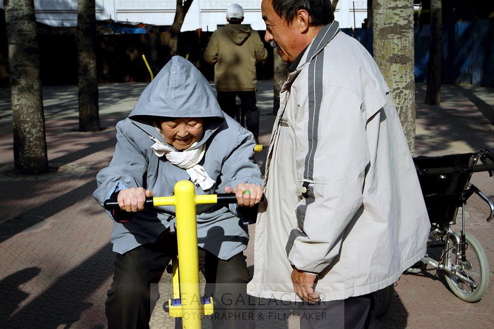 CHINA. Beijing. Elderly exercising in Ritan park. 2010