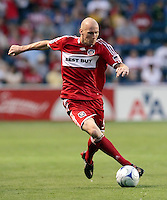 Chicago Fire defender Tim Ward (5) makes a move with the ball.  The Chicago Fire tied the Columbus Crew 0-0 at Toyota Park in Bridgeview, IL on July 11, 2009.