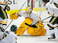 6 December 2009: University of Vermont Catamount goaltender Rob Madore, a Sophomore from Venetia, PA, makes a third period save against the University of New Hampshire Wildcats at Gutterson Fieldhouse in Burlington, Vermont. The Wildcats defeated the Catamounts 5-2 in the Hockey East matchup. Mandatory Credit: Ed Wolfstein Photo