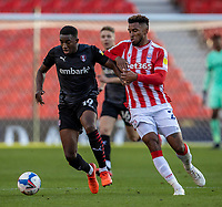 31st October 2020; Bet365 Stadium, Stoke, Staffordshire, England; English Football League Championship Football, Stoke City versus Rotherham United; Wes Harding of Rotherham United under pressure from Tyrese Campbell of Stoke City