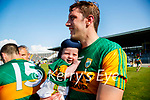 David Moran celebrates with son Eli after the Munster GAA Football Senior Championship Final match between Kerry and Cork at Fitzgerald Stadium in Killarney on Sunday.