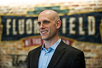 Ben Crockett, Red Sox Vice President of Player Development, talks with fans during the annual Hot Stove Event to promote the upcoming 2018 Greenville Drive baseball season on Monday, January 29, 2018, at Fluor Field at the West End in Greenville, South Carolina. (Tom Priddy/Four Seam Images)