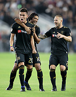 LOS ANGELES, CA - OCTOBER 29: Carlos Vela #10, Eduard Atuesta #20 and Jordan Harvey #2 of the Los Angeles FC celebrate an LAFC Eduard Atuesta goal during a game between Seattle Sounders FC and Los Angeles FC at Banc of California Stadium on October 29, 2019 in Los Angeles, California.