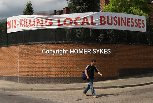Protest banner. Marshgate Lane industrial area. East London the site of the 2012 Olympic Games village and arena, Hackney Marsh, Stratford, England 2006.