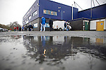 Chester City 1 Altrincham 3, 21/11/2009. Deva Stadium, Football Conference. Supporters arriving in the rain outside the Deva Stadium, Chester, home of Chester City Football Club, before kick-off in the club's Blue Square Premier fixture against Cheshire rivals Altrincham. The visitors won by three goals to one. Chester were in administration at the start of the season and were penalised 25 points before the season began. Photo by Colin McPherson.