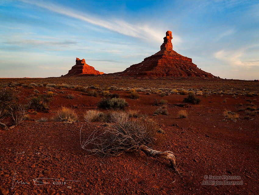 Sunset at Valley of The Gods, Utah ©2018 James D Peterson.  The last light of the day casts a warm glow on these eroded sandstone monuments near the town of Mexican Hat.