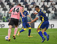 Calcio, Serie A: Juventus - Hellas Verona, Turin, Allianz Stadium, October 25, 2020.<br /> Juventus' Dejan Kulusevsky  (l) is going to score in spite of  Hellas Verona's captain Davide Faraoni (r) during the Italian Serie A football match between Juventus and Hellas Verona at the Allianz stadium in Turin, October 25,,2020.<br /> UPDATE IMAGES PRESS/Isabella Bonotto