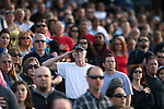 The crowd listens to the National Anthem before a Reno Aces game in Reno, Nev., on Saturday, April 18, 2015.<br /> Photo by Cathleen Allison
