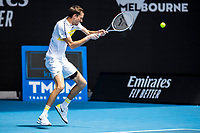 13th February 2021, Melbourne, Victoria, Australia; Daniil Medvedev of Russia returns the ball during round 3 of the 2021 Australian Open on February 13 2020, at Melbourne Park in Melbourne, Australia.