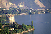 Montreux, Switzerland. Breathtaking view of Chateau de Chillon castle on the shore of Lake Geneva (Lac Leman) with mountains.