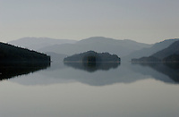 Morning reflections in still water are a mirror of islands and scenery on a rare clear day near Sitka, Alaska.