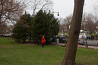 A television reporter broadcasts from Boston Common in Boston, Mass., on April 16, 2013, the day after bombings at the Boston Marathon.