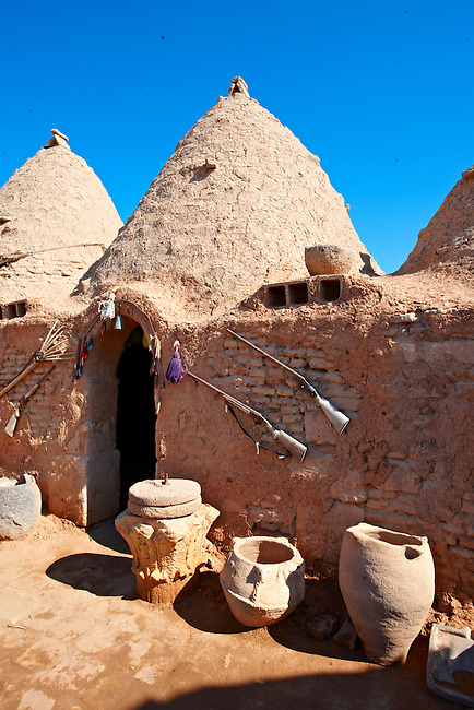 """Pictures of the beehive adobe buildings of Harran, south west Anatolia, Turkey.  Harran was a major ancient city in Upper Mesopotamia whose site is near the modern village of Altınbaşak, Turkey, 24 miles (44 kilometers) southeast of Şanlıurfa. The location is in a district of Şanlıurfa Province that is also named """"Harran"""". Harran is famous for its traditional 'beehive' adobe houses, constructed entirely without wood. The design of these makes them cool inside. 17"""