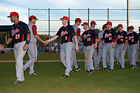 Illinois State Redbirds Jean Ramirez (27), Owen Miller (8), Mitch Vogrin (20), Jeff Lindgren (21), Derek Parola (16), and Marcus McKinney (17) shake hands after a game against the Indiana Hoosiers on March 4, 2016 at North Charlotte Regional Park in Port Charlotte, Florida.  Indiana defeated Illinois State 14-1.  (Mike Janes/Four Seam Images)