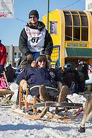 Wade Marrs and team leave the ceremonial start line at 4th Avenue and D street in downtown Anchorage during the 2014 Iditarod race.<br /> Photo by Jim R. Kohl/IditarodPhotos.com