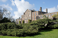 The low bough of a cedar tree planted by Capability Brown graces the lawn in front of Aynhoe Park