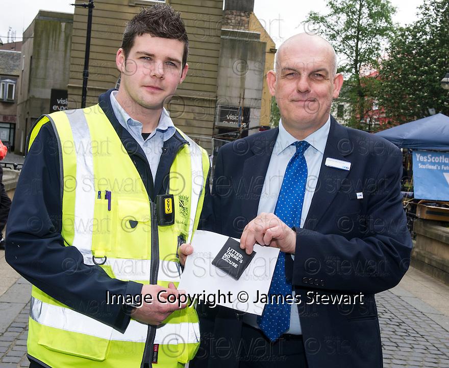 The Litter Strategy team £80 Litter Fine Information Day.... Stephen McTeirnan (right) receives a spot prize for using a High Street Litter Bin to dispose of his litter.