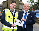 The Litter Strategy team £80 Litter Fine Information Day.... Stephen McTeirnan (right) receives a spot prize for using a High Street Litter Bin to dispose of his litter.