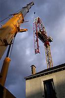 Bent construction crane after a violent wind storm.
