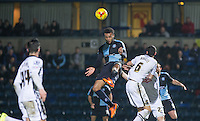 Aaron Amadi-Holloway of Wycombe Wanderers wins the ball in the air during the Sky Bet League 2 match between Wycombe Wanderers and Notts County at Adams Park, High Wycombe, England on 15 December 2015. Photo by Andy Rowland.