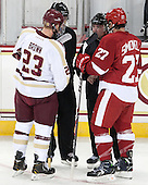 Patrick Brown (BC - 23), Keith Kaval, Jeff Bunyon, Frankie Simonelli (Wisconsin - 27) - The Boston College Eagles defeated the visiting University of Wisconsin Badgers 9-2 on Friday, October 18, 2013, at Kelley Rink in Conte Forum in Chestnut Hill, Massachusetts.