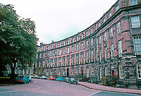 Edinburgh: Ainslee Place--Great Stuart St. connecting to the larger Moray Place to the right. Wide street with brick road.  Photo '87.