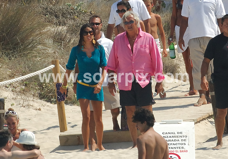 **ALL ROUND PICTURES FROM SOLARPIX.COM**.**WORLDWIDE SYNDICATION RIGHTS EXCLUDING SPAIN - NO PUBLICATION IN SPAIN**.Formula One boss and Italian businessman Flavio Briatore and his recent new wife Elisabetta Gregaoraci headed over to the Spanish island of Ibiza this week, for a relaxing getaway with some family and friends including Alejandro Agag and Ana Aznar. ..This pic: Elisabetta Gregaoraci and Flavio Briatore..JOB REF: 7117 MAD       DATE: 25_08_2008.**MUST CREDIT SOLARPIX.COM OR DOUBLE FEE WILL BE CHARGED* *UNDER NO CIRCUMSTANCES IS THIS IMAGE TO BE REPRODUCED FOR ANY ONLINE EDITION WITHOUT PRIOR PERMISSION*