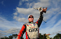 Sept. 5, 2011; Claremont, IN, USA: NHRA funny car driver Mike Neff celebrates after winning the US Nationals at Lucas Oil Raceway. Mandatory Credit: Mark J. Rebilas-