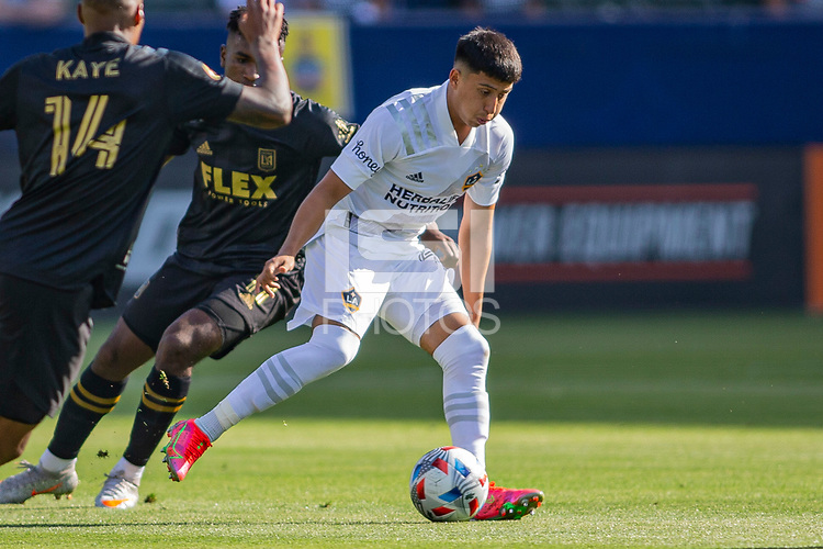 CARSON, CA - MAY 8: Adam Saldana  #43 of the Los Angeles Galaxy moves with the ball during a game between Los Angeles FC and Los Angeles Galaxy at Dignity Health Sports Park on May 8, 2021 in Carson, California.