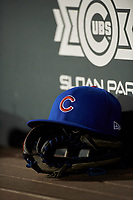 A Chicago Cubs hat rests on a baseball glove during an Arizona League game between the AZL Padres 1 and AZL Cubs 1 on July 5, 2019 at Sloan Park in Mesa, Arizona. The AZL Cubs 1 defeated the AZL Padres 1 9-3. (Zachary Lucy/Four Seam Images)