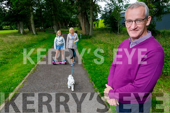 Cllr Michael Kennelly in the Listowel town park on Tuesday with Betty and Olivia Rulik and Ben the dog as he is trying to highlight that all dogs should be on a leash in the park