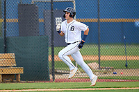 FCL Tigers West Izaac Pacheco (35) scores a run during a game against the FCL Yankees on July 31, 2021 at Tigertown in Lakeland, Florida.  (Mike Janes/Four Seam Images)