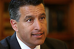 Gov. Brian Sandoval answers media questions at a press conference at the Capitol in Carson City, Nev., on Monday, May 13, 2013. Sandoval unveiled a plan to increase state funding for English language learners and reduce kindergarten class size. .Photo by Cathleen Allison