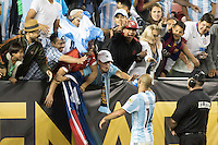 Santa Clara, CA - Monday June 6, 2016: Argentina's (14) Javier Mascherano gives his armband to a fan. Argentina played Chile in the group D match of the Copa América Centenario game at Levi's Stadium.