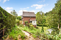 BNPS.co.uk (01202 558833)<br /> Pic: Homesestateagency/BNPS<br /> <br /> Pictured: The house and garden.<br /> <br /> A timewarp home that has been lived in by the same family for more than a century has gone on sale for the first time since being built.<br /> <br /> At the time the property was built, King Edward VII was on the throne and the First World War had not even started.<br /> <br /> The property is being sold for £550,000 under probate by the original builder's three grandchildren, who were born in the Victorian-style house.<br /> <br /> The two-bedroomed home is in the Surrey town of Haslemere and belonged to the Berry family, who decided to sell after the death of their parents, Freda and Leslie.