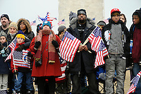 A crowd fills The Mall during the Opening Inaugural Celebration two days before the inauguration of Barack Obama as the 44th President of the United States. Amongst them are Lloyd Hardy (centre right), 33 of Washington DC and his sons, Bernard Trowell, 15, and Travis Morris, 16.