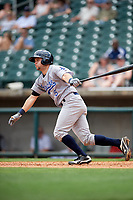Pensacola Blue Wahoos catcher Chris Okey (5) follows through on a swing during a game against the Birmingham Barons on May 9, 2018 at Regions Field in Birmingham, Alabama.  Birmingham defeated Pensacola 16-3.  (Mike Janes/Four Seam Images)