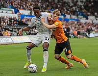 11th September 2021; Swansea.com Stadium, Swansea, Wales; EFL Championship football, Swansea versus Hull City; Ethan Laird of Swansea City and Keane Lewis-Potter of Hull City jostle for possession
