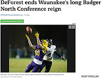 DeForest's Lane Larson completes a reception in front of Waunakee's Lawson Ludwig in the second quarter, as Waunakee takes on DeForest for the Wisconsin Badger North Conference high school football championship on Friday, 10/18/19 at DeForest High School | Wisconsin State Journal article front page C1 & C6 Sports 10/19/19 and online at https://madison.com/wsj/sports/high-school/football/deforest-ends-waunakee-s-long-badger-north-conference-reign/article_b2531b43-2025-5cb0-8695-4cd3ae6ce82c.html