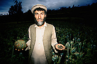 Nuristani farmer with wet Opium to be store and on the right, dry opium to be transform in to heroin in the Eastern Afghan/Pakistani border.